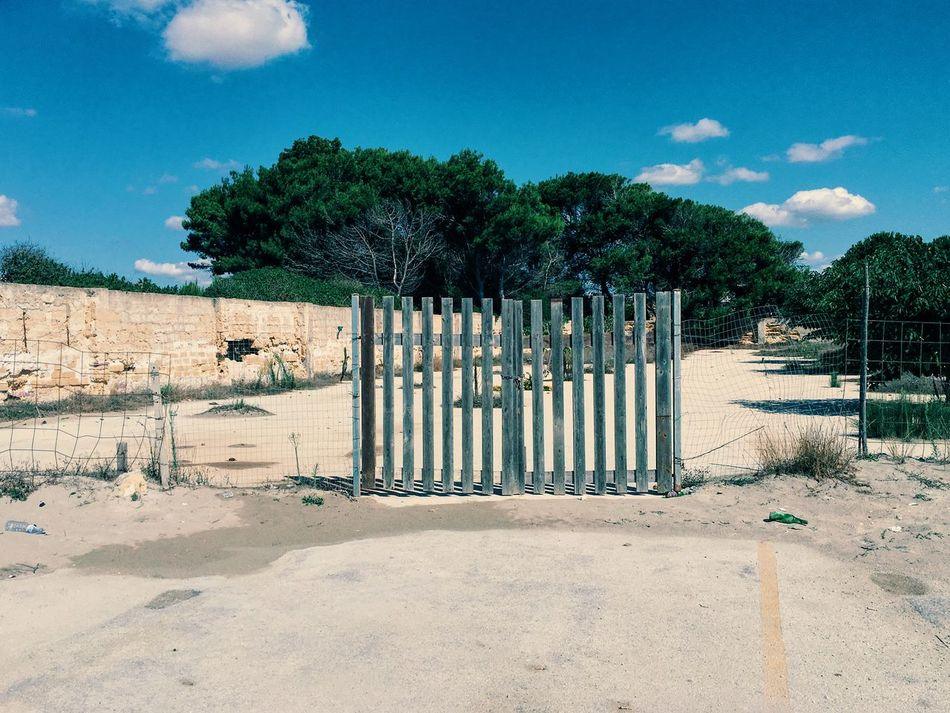 """""""Shut in/out"""" Just don't get it - am I being left in or out?One of those moments that will make you realise that establishing the point of view is everything. iPhone 6s, processed with #VSCO + C3 preset Blue Blue Sky Day Gate Gates Gateway In And Out No People Outdoors Sicilia Sicily Sky Sunny Sunny Day Tree"""