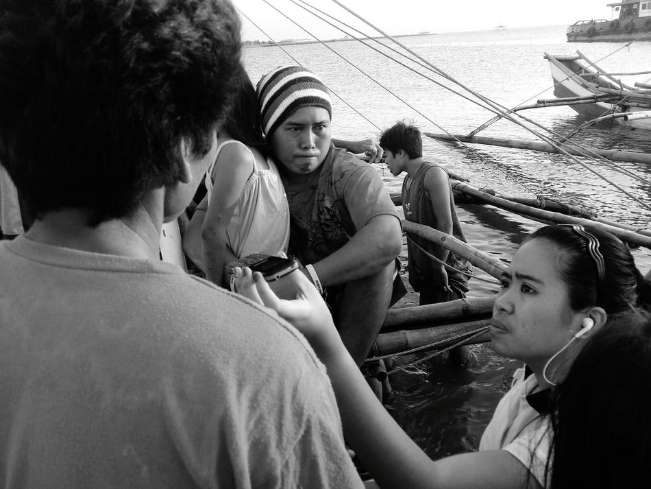 This fisherman was interviewed by a radio reporter after his son was found lifeless floating in Bacolod, Philippines waters.The Photojournalist - 2016 EyeEm Awards Interview Reporter Media Black And White Tragedy Father Sea Fisherman Emotions Monochrome Photography