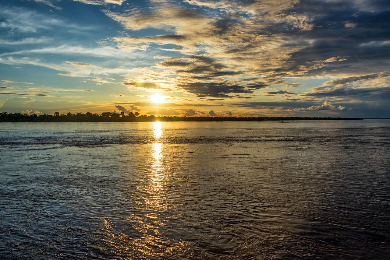 Sunset over the Amazon river near Leticia, Colombia Amazon Amazon River Amazonas Amazonia Brazil Clouds Colombia Jungle Landscape Leticia Nature Nature Outdoors Rain Forest Rainforest River Sky South America Sun Sunrise Sunset Tabatinga Water