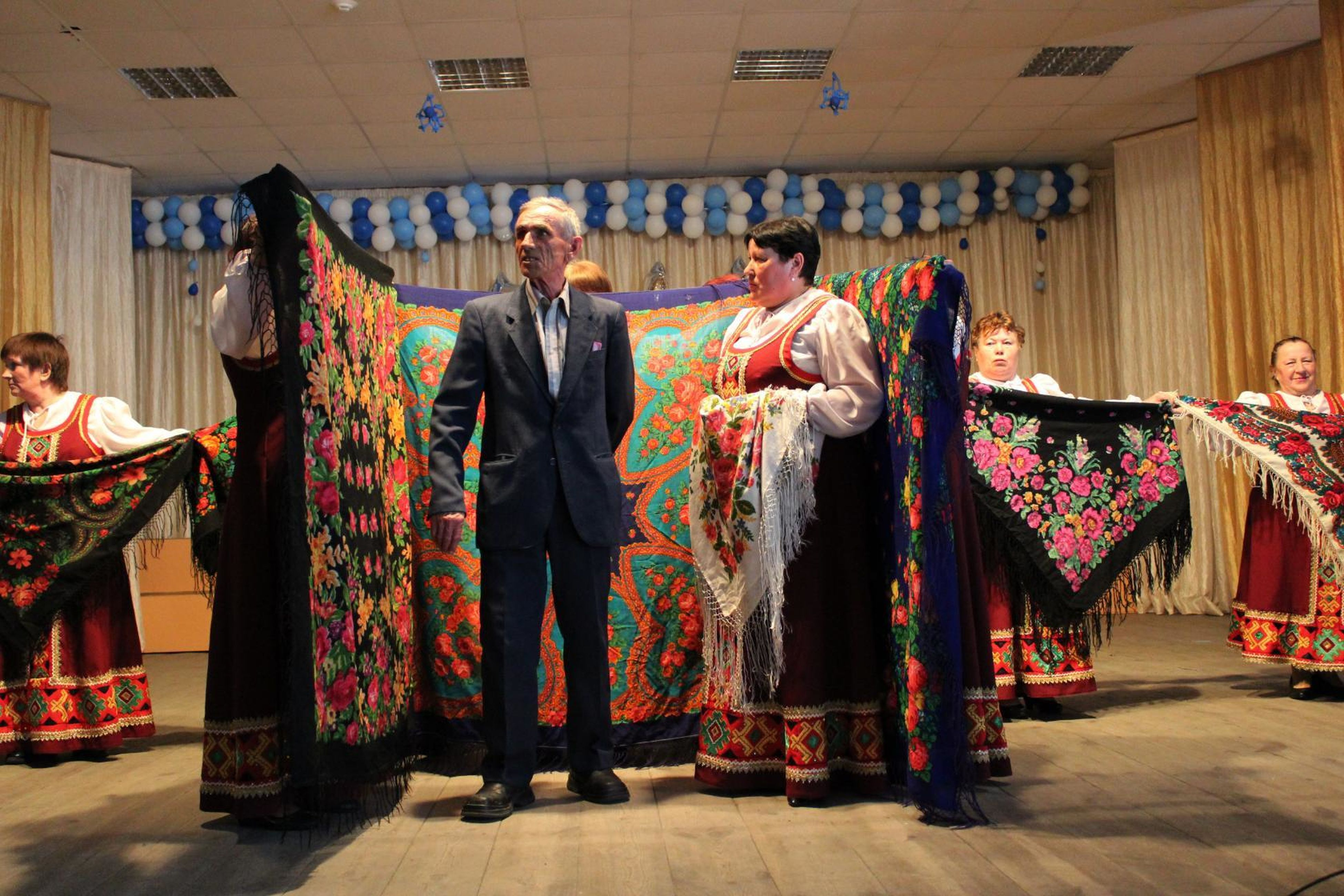 traditional clothing, full length, medium group of people, standing, front view, arts culture and entertainment, performance, indoors, multi colored, women, well-dressed, men, adult, people, day, young women, adults only, young adult