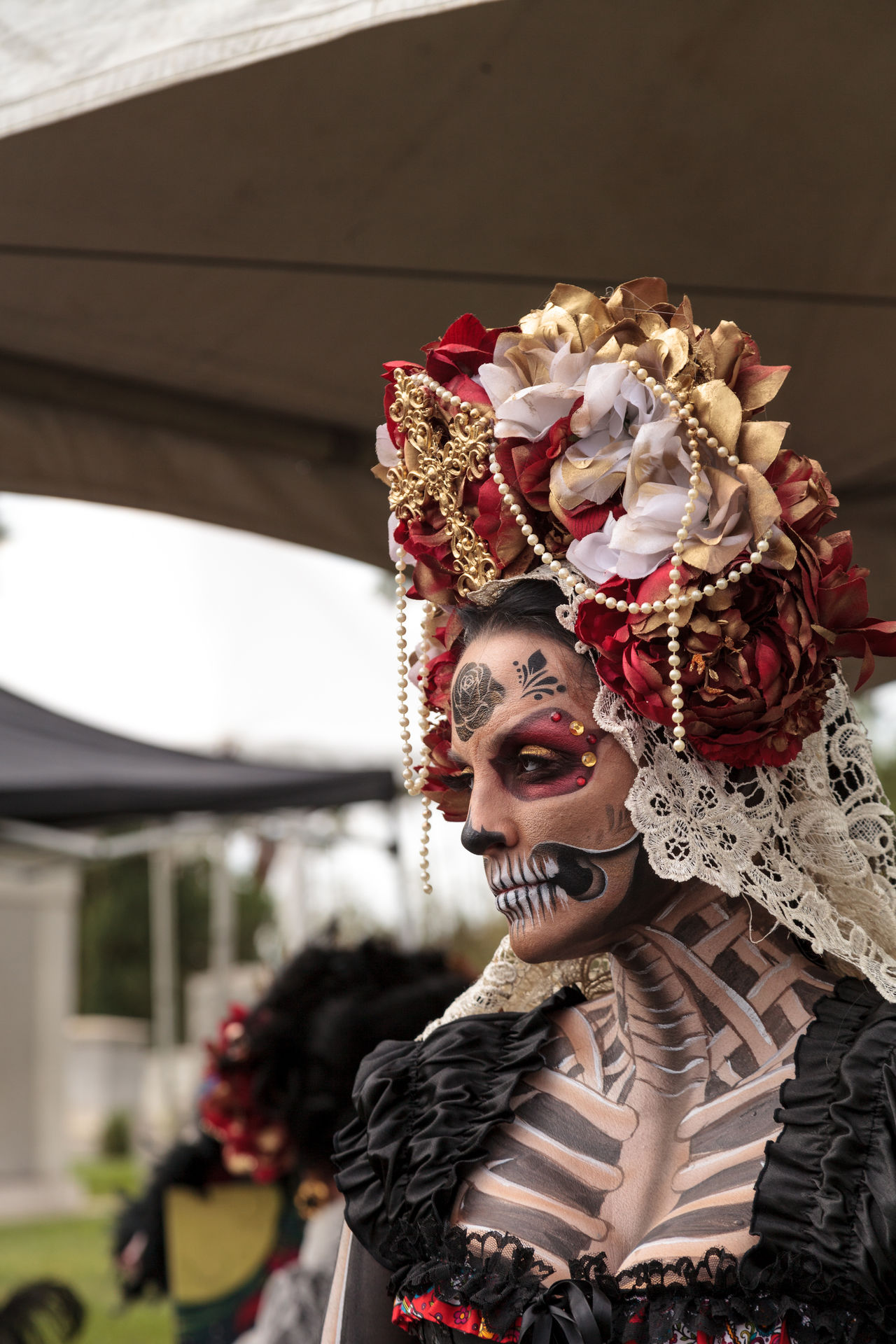 Los Angeles, CA, USA - October 29, 2016: Skeleton woman performer at Dia de los Muertos, Day of the dead, in Los Angeles at the Hollywood Forever Cemetery grounds. Editorial use only. Adult Adults Only All Saints Day Costume Day Day Of The Dead Dia De Los Muertos Face Paint Ghoul Ghoulish Gothic Headdress Outdoors People Skeleton Skull Steam Punk Woman