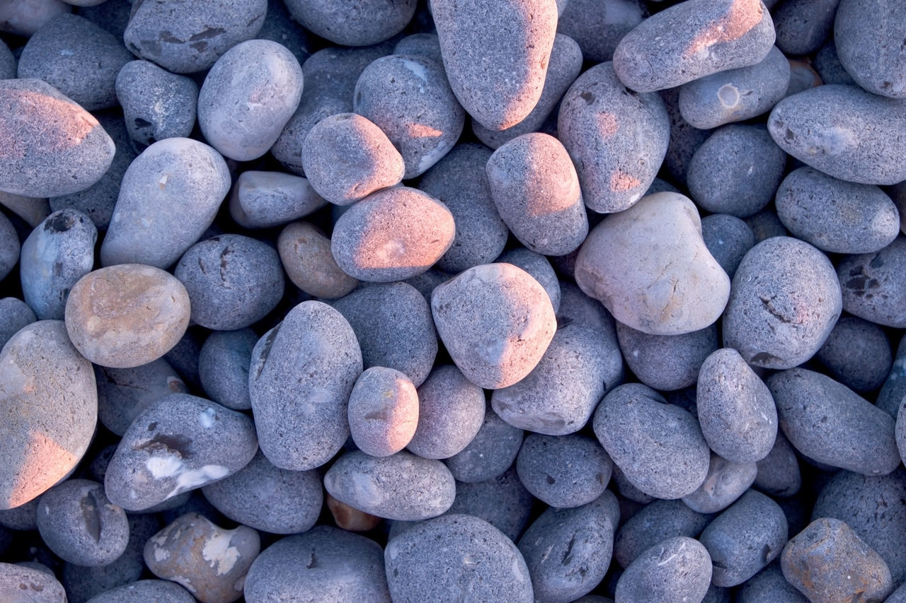 Backgrounds Beach Close-up Day Full Frame Large Group Of Objects Nature No People Outdoors Pebble Pebble Beach Pebbles Beach Pebbles On A Beach Sky Stone - Object Sunset Lighting  Volcanic Rock