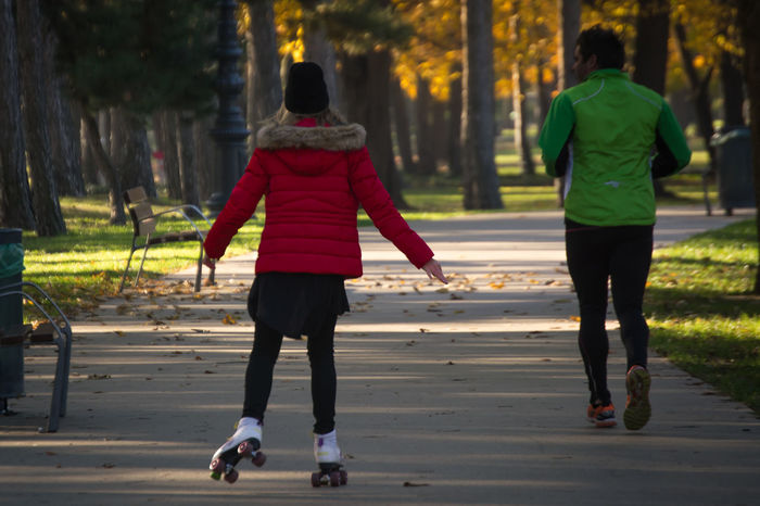 Autumn Running Day Leisure Activity Lifestyles Nature Outdoors Park Rear View Rollerskate Rollerskating Togetherness Tree Two People Warm Clothing Women