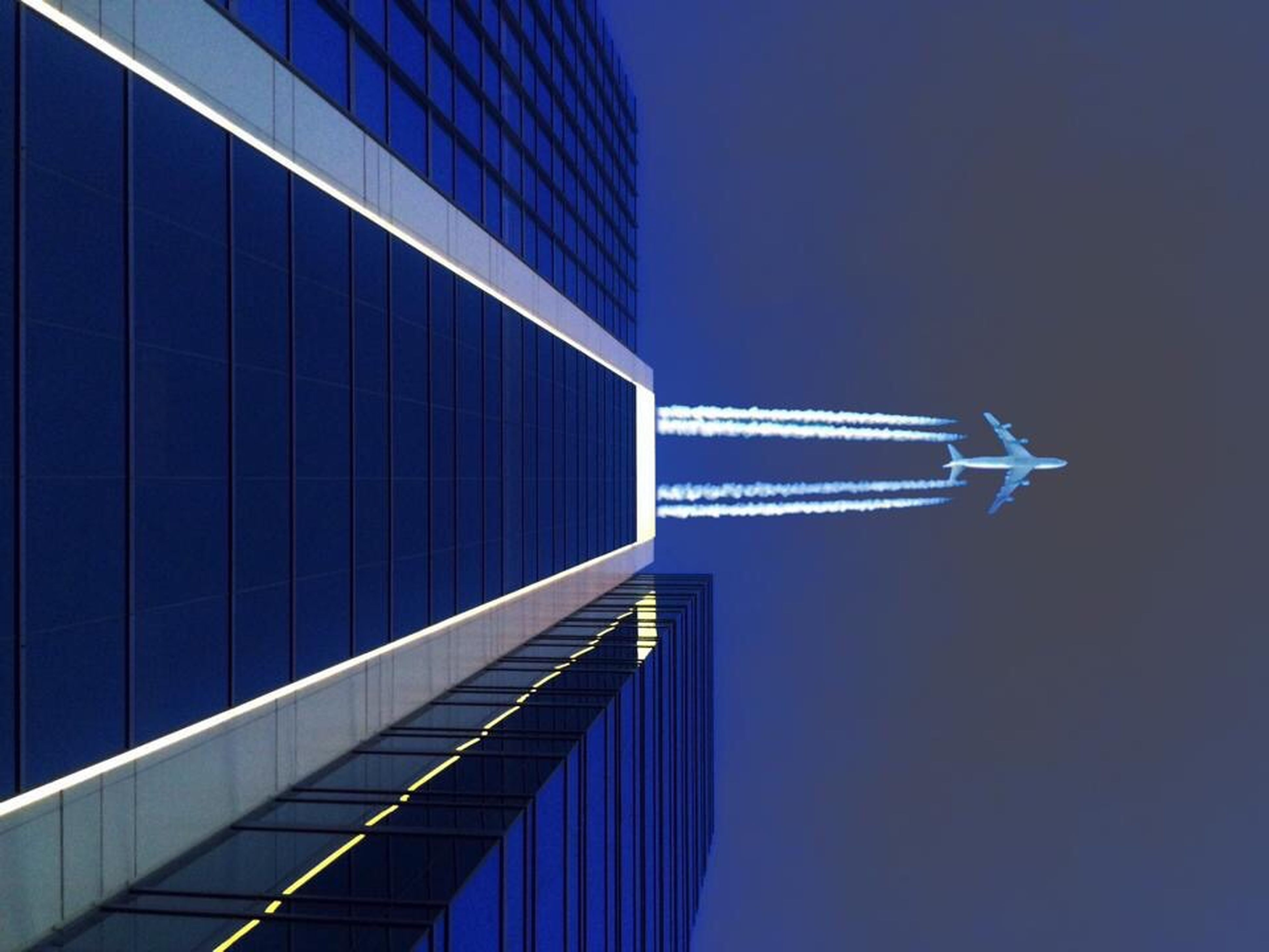 architecture, built structure, building exterior, low angle view, modern, city, skyscraper, tall - high, office building, blue, clear sky, tower, capital cities, sky, famous place, travel destinations, outdoors, travel, tall, no people