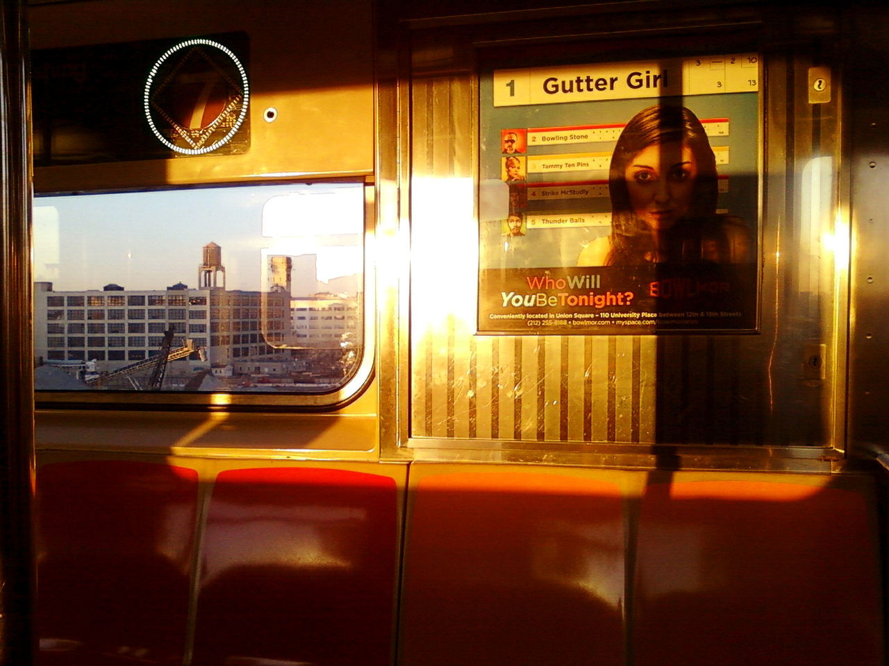 glass - material, text, reflection, window, real people, public transportation, indoors, communication, land vehicle, transportation, one person, illuminated, train - vehicle, lifestyles, young women, architecture, young adult, day