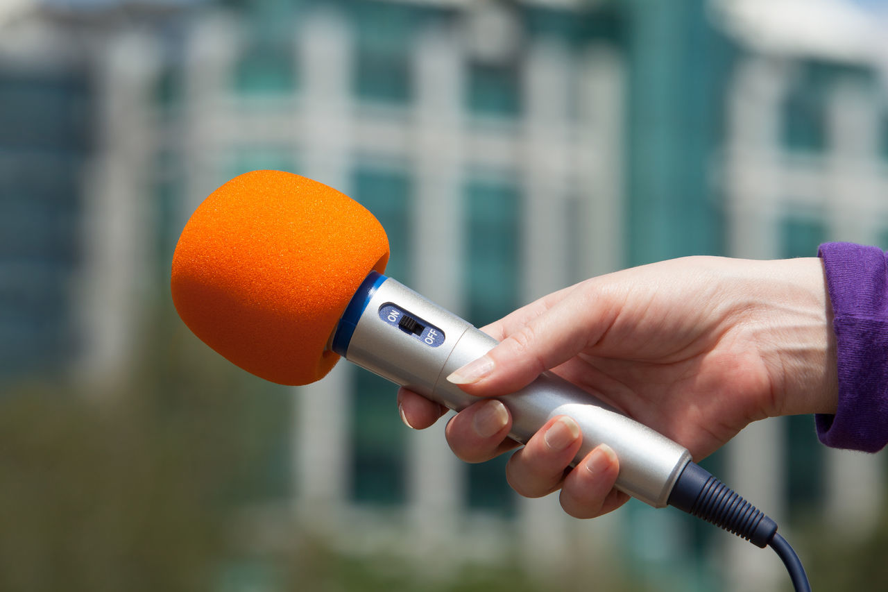 Inteview with microphone. Press interview Adult Audio Broadcasting Close-up Conference Day Hand Holding Holding Hands Human Finger Interview Journalist Lifestyles Me Microphone Outdoors People Press Technology