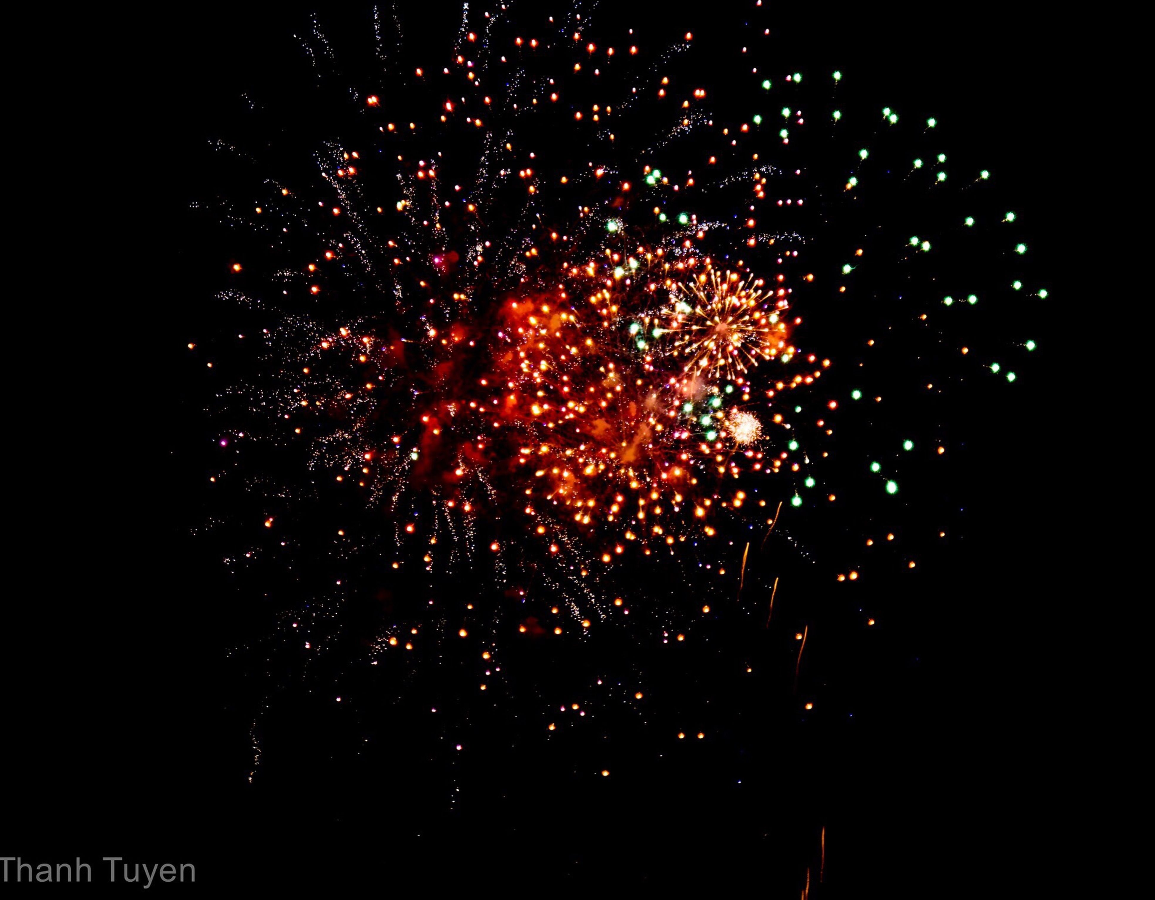 motion, celebration, firework display, long exposure, exploding, glowing, arts culture and entertainment, night, low angle view, firework - man made object, sparks, sky, entertainment, event, blurred motion, illuminated, multi colored, outdoors, vibrant color, red, no people