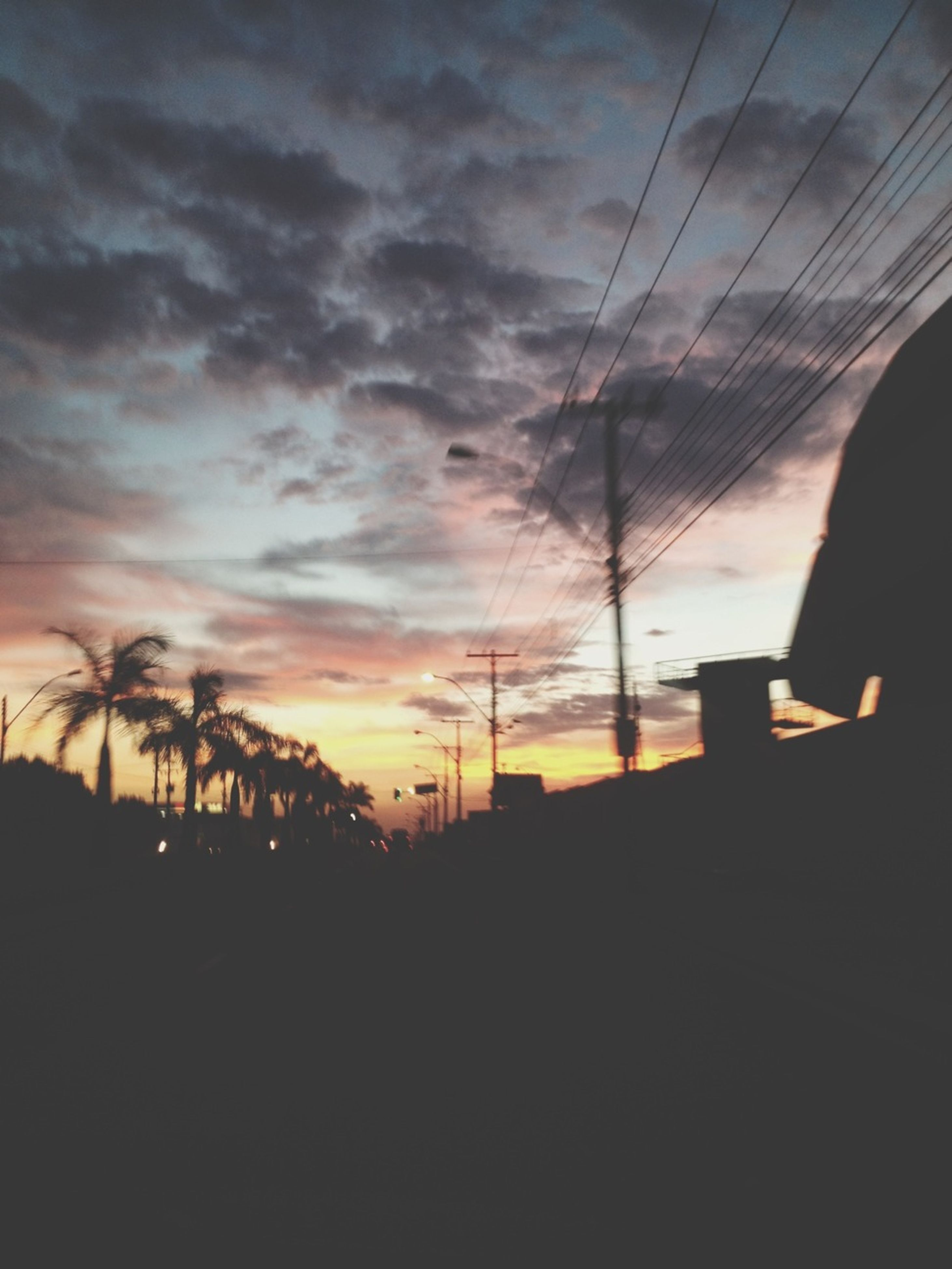 silhouette, sunset, sky, cloud - sky, dark, outline, orange color, tree, dusk, cloud, nature, beauty in nature, scenics, tranquility, tranquil scene, outdoors, street light, low angle view