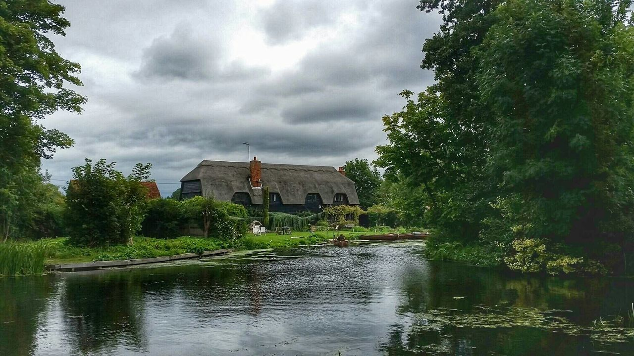 architecture, tree, built structure, water, sky, no people, building exterior, nature, outdoors, day, watermill, beauty in nature