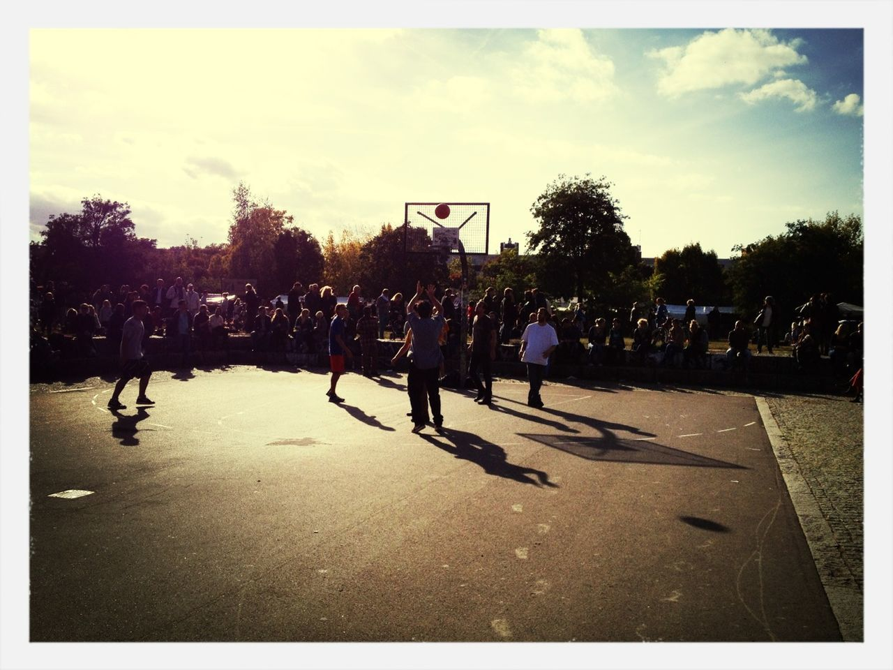 large group of people, tree, men, leisure activity, silhouette, outdoors, sport, teamwork, court, real people, people, day, basketball - sport, sky, adult, adults only