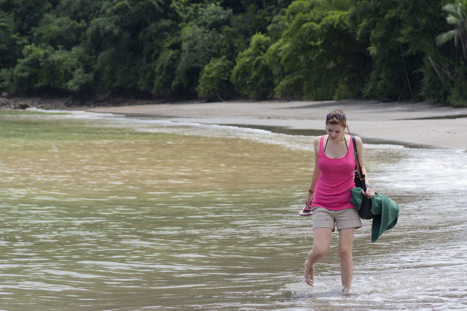 Young woman at the beach in Punta Leona, Costa Rica Adventure Ankle Deep In Water Beach Beach Photography Costa Rica Forest Full Length Leisure Activity Lifestyles Loneliness Looking Down One Woman Only One Young Woman Only Punta Leona Puntarenas Summer Tropical Climate Vacations Walking Water Wet Woman Woods Young Young Women