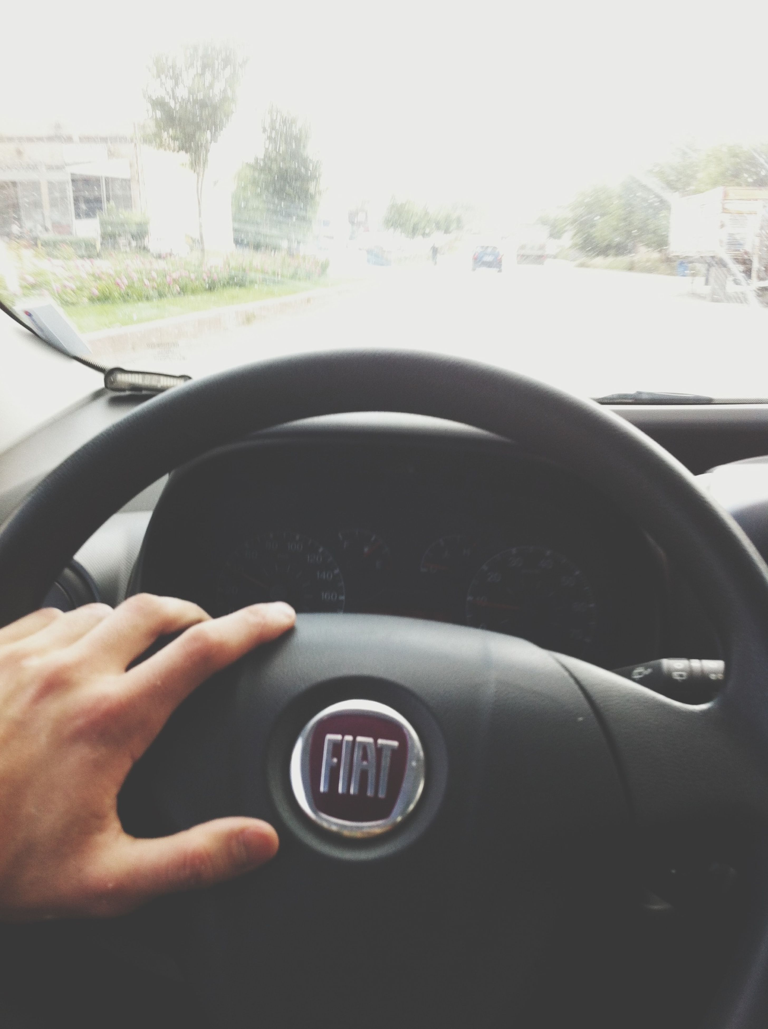 transportation, car, mode of transport, land vehicle, part of, vehicle interior, person, cropped, car interior, side-view mirror, reflection, glass - material, close-up, transparent, travel, road, windshield