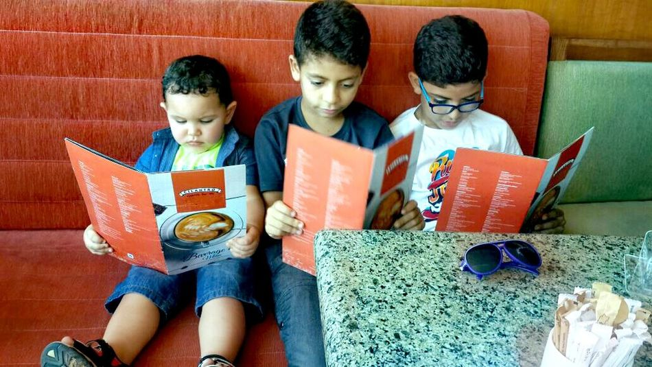 Togetherness Leisure Activity Lifestyles Bonding Casual Clothing Freshness Arrangement Kids Kidsphotography Kids_of_our_world Reading Time Ordering Food