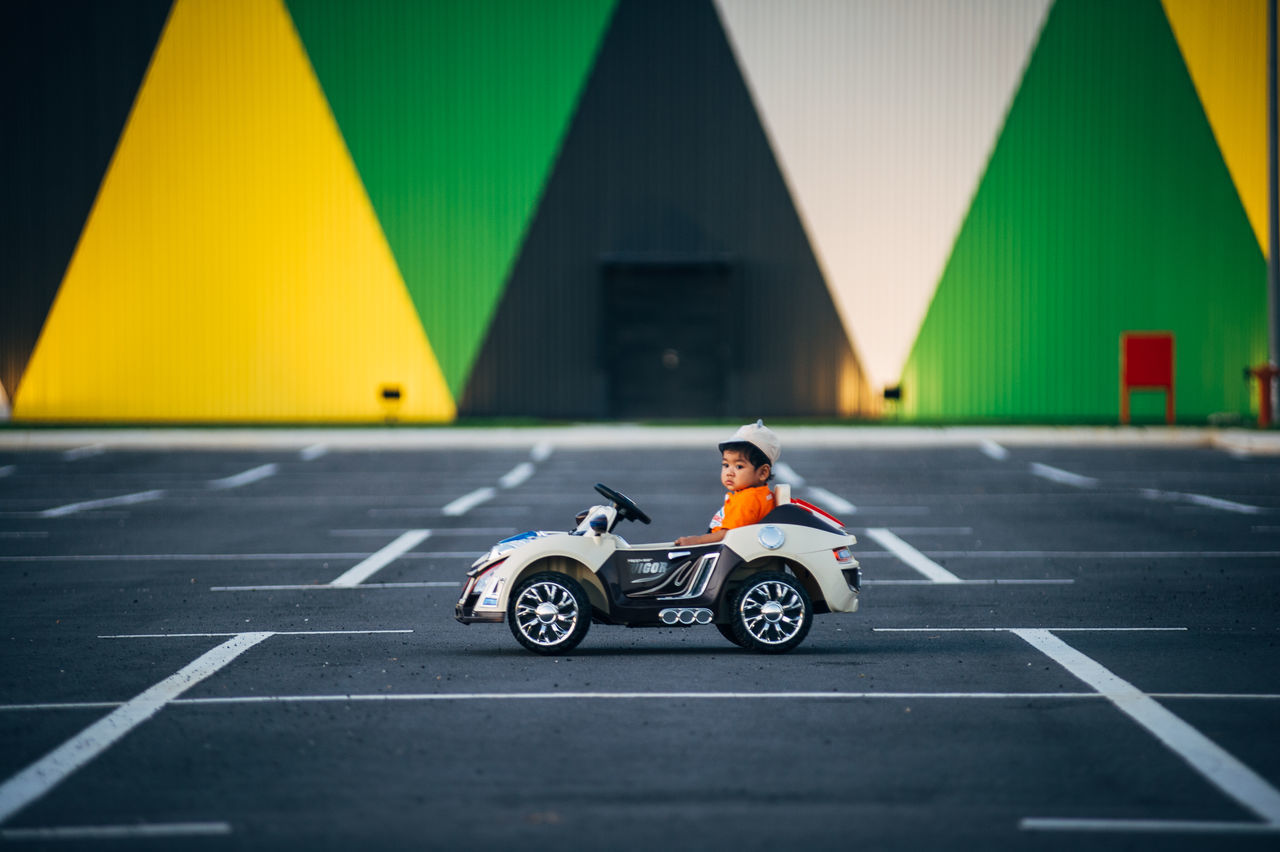 Adults Only Childhood Competition Competitive Sport Day Full Length Motorsport One Man Only One Person Outdoors Parking Lot People Sports Race Sports Track Toy Car Young Adult