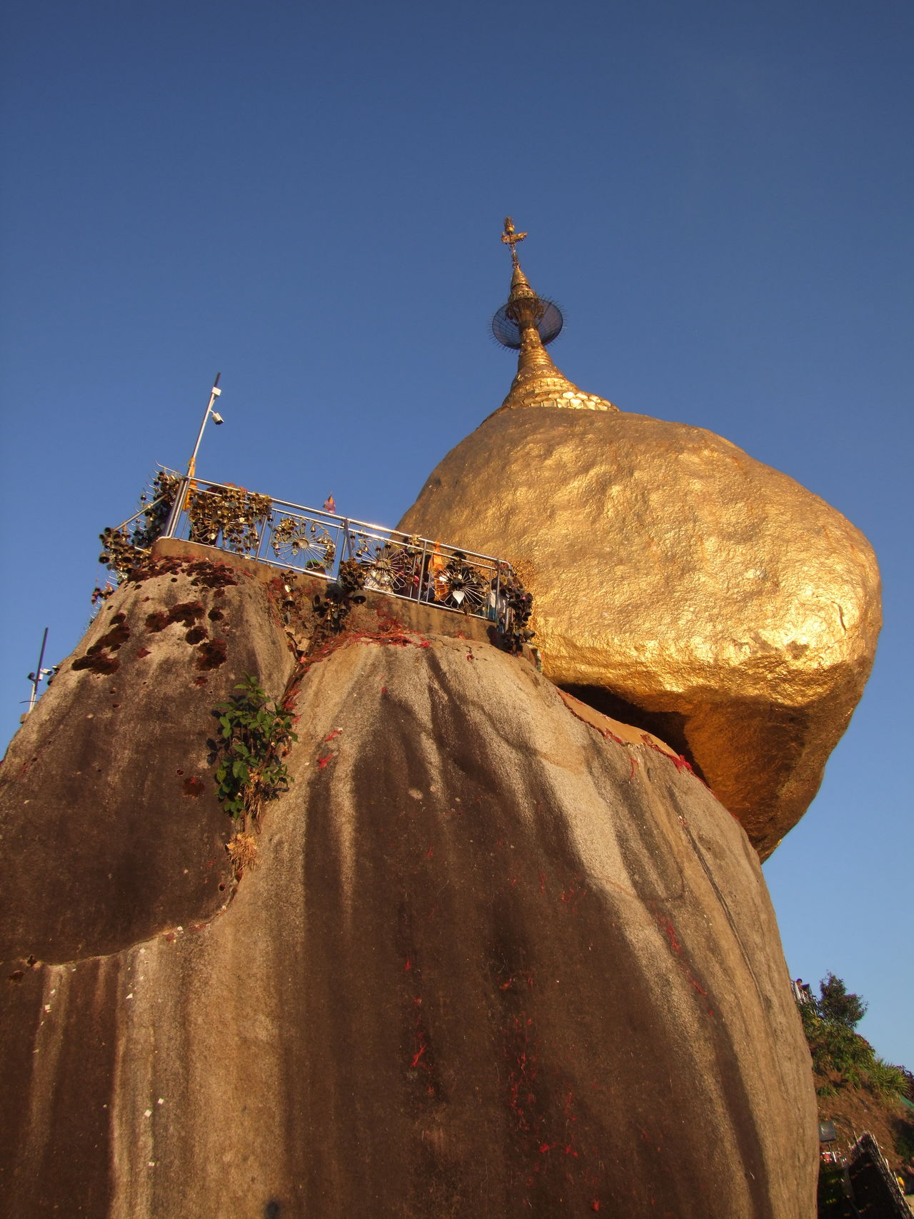 Golden Rock at Mount Kyaiktiyo Pagoda Blue Sky Buddhism Buddhism Culture Composition Gold Coloured Golden Rock Golden Rock Pagoda Kinpun Low Angle View Mount Kyaiktiyo Mount Kyaiktiyo Pagoda Myanmar No People Outdoor Photography Place Of Pilgrimage Place Of Prayer Place Of Worship Religion Rocka Shining Sunlight And Shade Tourism Tourist Attraction  Tourist Destination Travel Destination