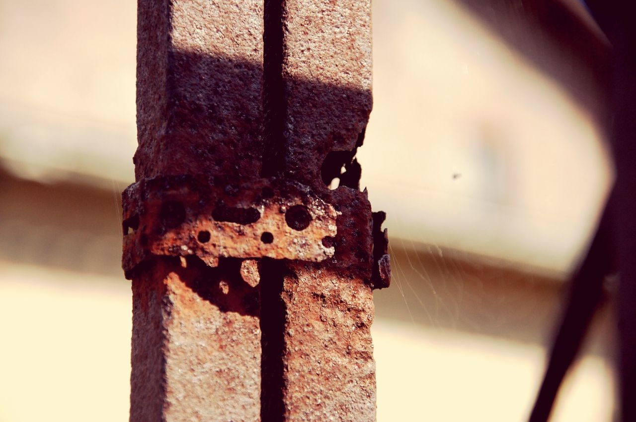 Iron Rusty Construction Small Detail Focus On Foreground Close-up Outdoors No People Brown Day Sunshine on rusty Iron.