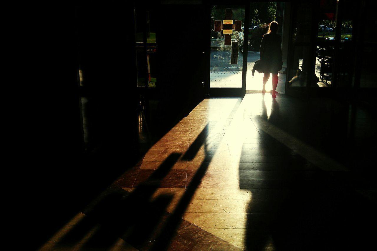Full Length Of Silhouette Woman Walking In Building