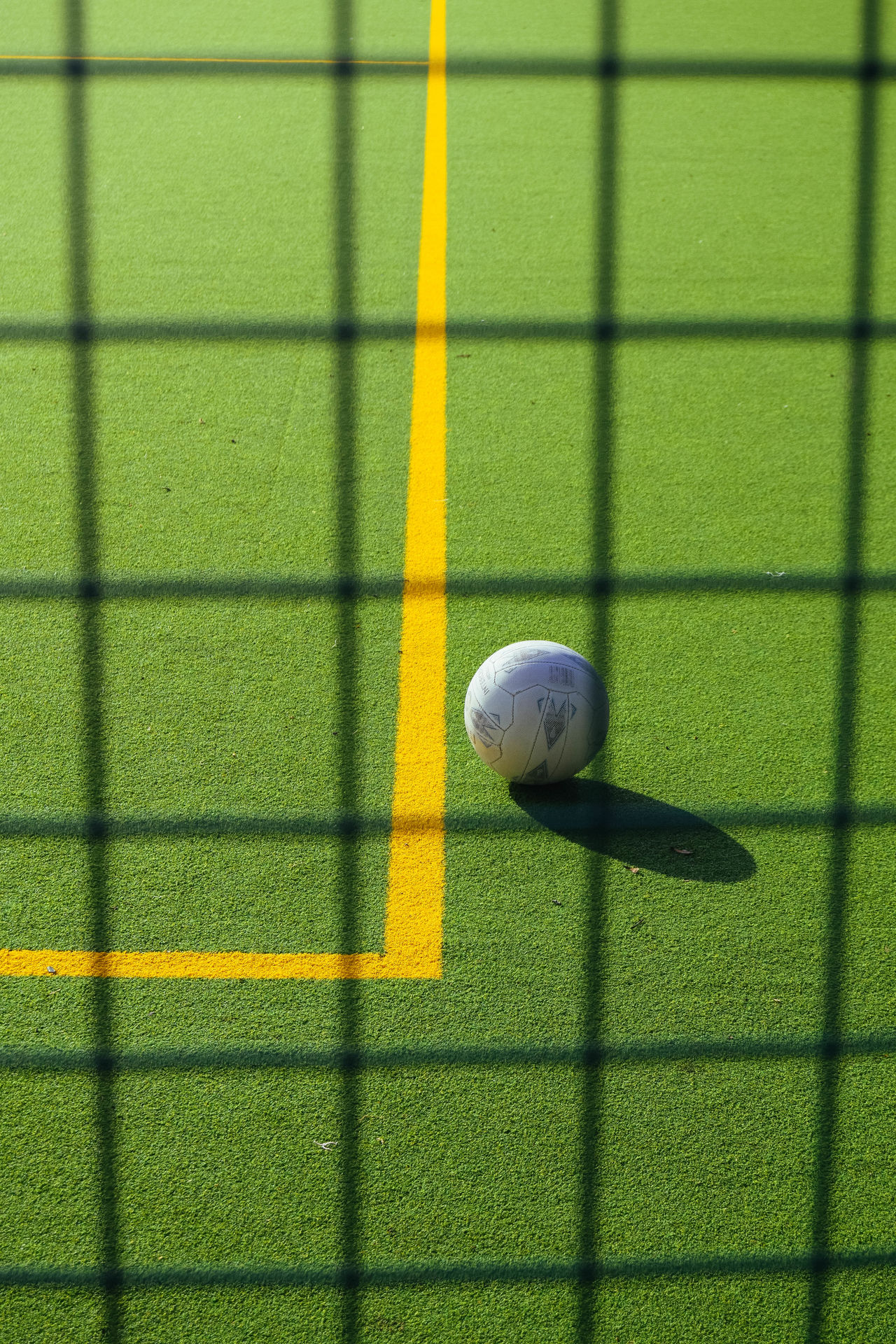 Artificial Grass Ball Close-up Day Football Net No People Outdoors Soccer Sport Sunlight Yellow Astro Turf Line Marking Sports Court