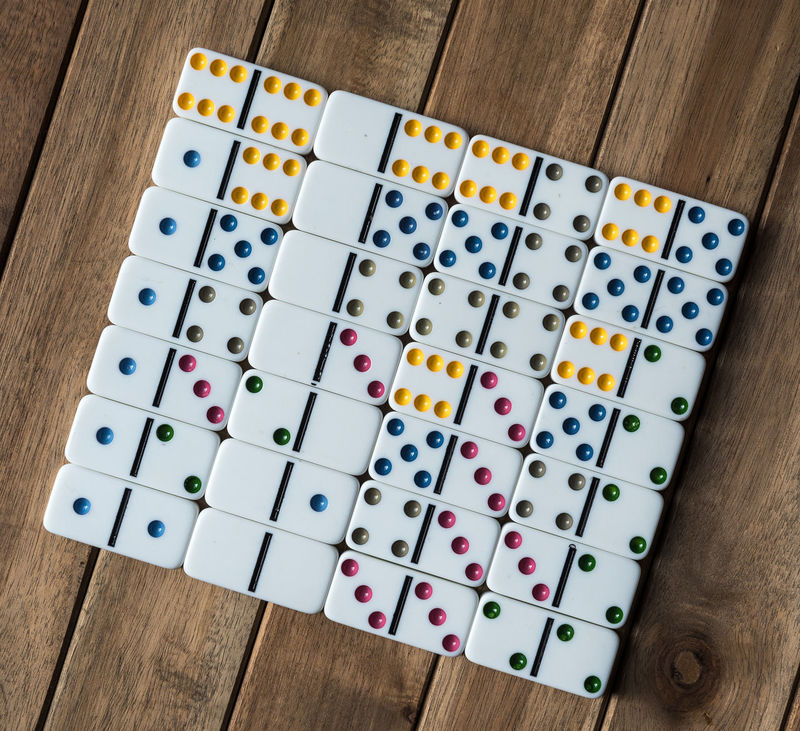 Dominoes on wooden table Close-up Dominoes Dominos Game In Row Indoors  Large Group Of Object Multi Colored No People Play Still Life Table Variation Lights White Wood Wood - Material