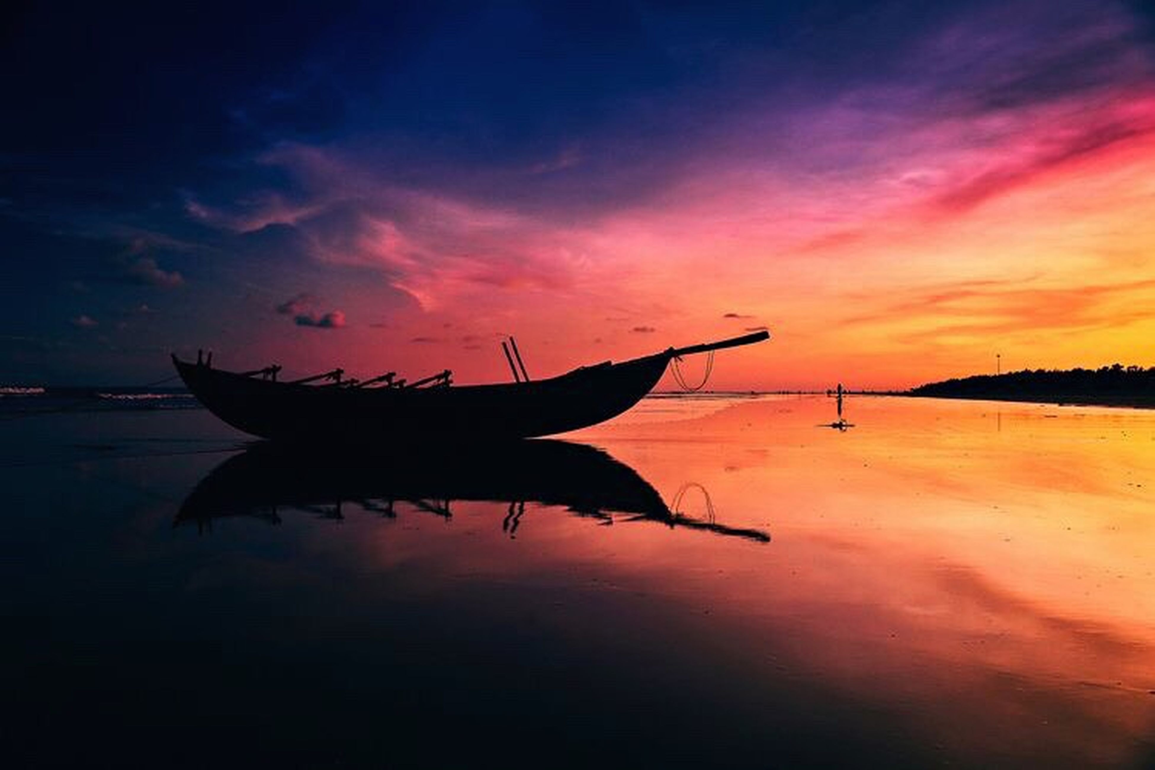 sunset, animal themes, orange color, water, sky, animals in the wild, one animal, wildlife, sea, reflection, flying, silhouette, beauty in nature, nature, cloud - sky, waterfront, scenics, spread wings, tranquility, outdoors