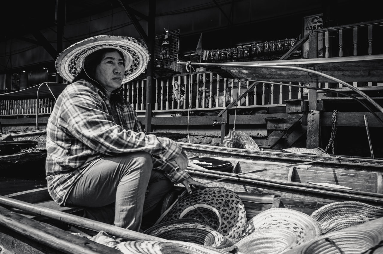 Adult Adults Only Black And White Boat Business Day Floating Market Goods Hat Hats Headwear Lifestyles Market Monochrome One Person Outdoors People Period Costume Portrait Sitting Traditional Culture Travel Destinations Woman Working Young Adult The Portraitist - 2017 EyeEm Awards The Photojournalist - 2017 EyeEm Awards