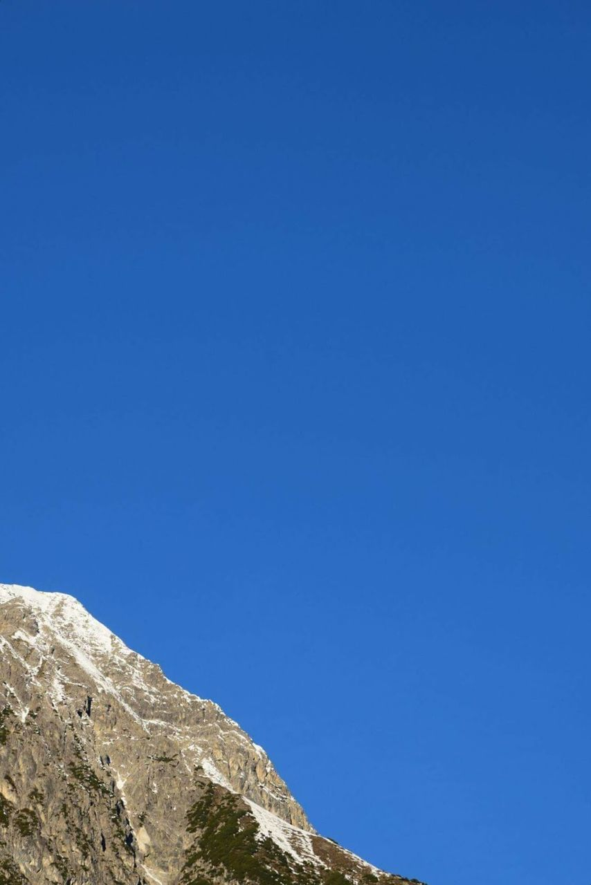 blue, clear sky, copy space, nature, beauty in nature, day, tranquil scene, tranquility, outdoors, scenics, no people, low angle view, mountain, sky