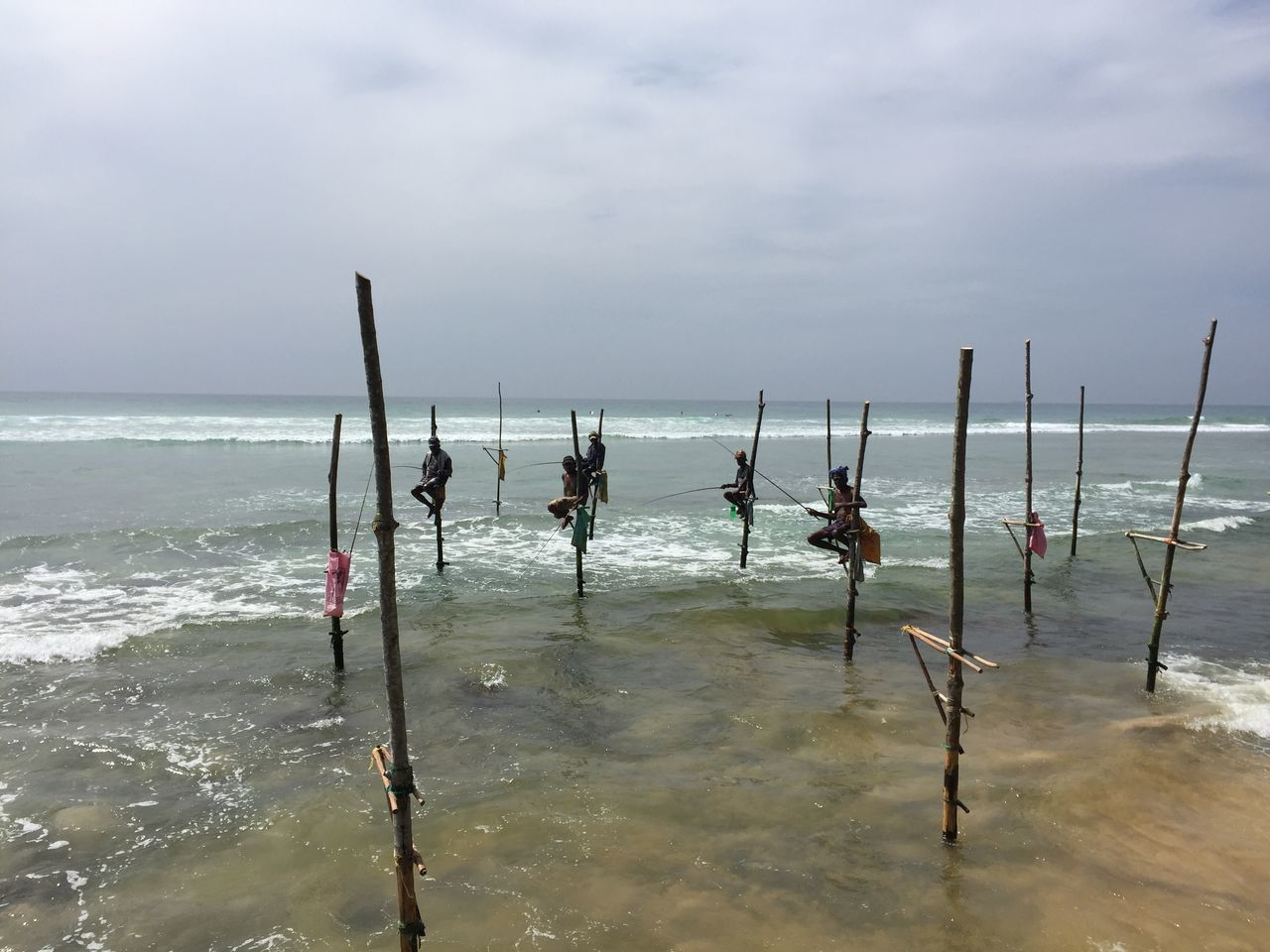 Beach Beauty In Nature Cloud - Sky Day Fishermen Fishersmen On Sticks Horizon Over Water Nature Outdoors Outrigger Sand Scenics Sea Sky Sri Lanka Sri Lanka Travel Sri Lankan Sri Lankan Fishier Travel Destinations Water