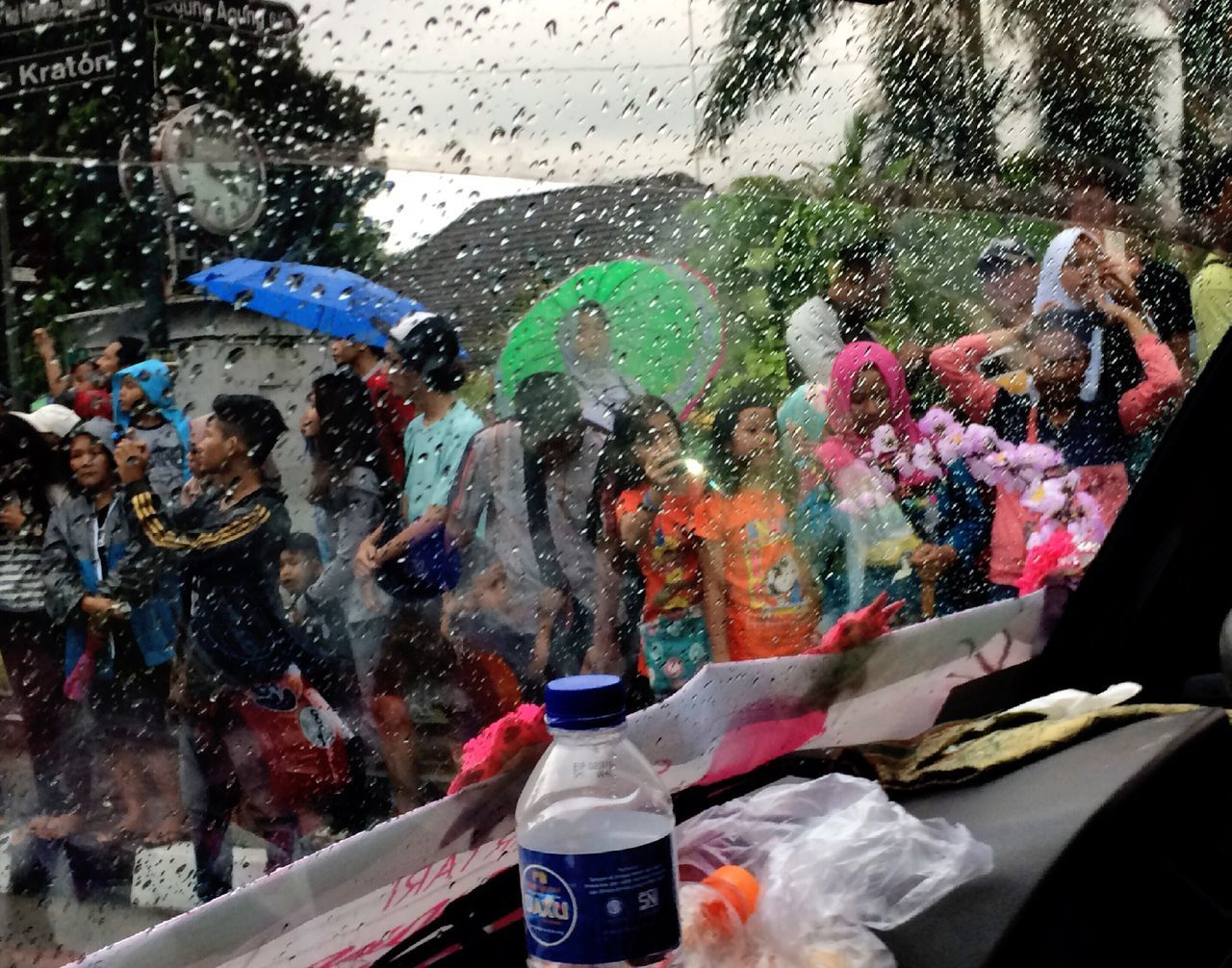 Multi Colored Large Group Of People Crowd Raindrops Mirror Participant Audience Arts Culture And Entertainment Celebration Iphone5s IPhoneography Iphonesia