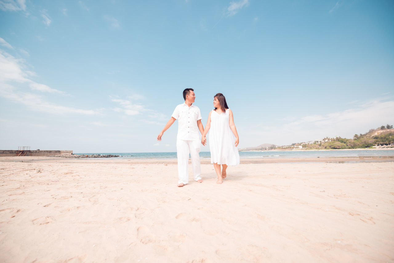 Adult Adults Only Beach Blue Bonding Carefree Clear Sky Connection Full Length Heterosexual Couple Love Nature Outdoors Relaxation Sand Sea Sky Summer Togetherness Travel Travel Destinations Tropical Climate Two People Vacations Women