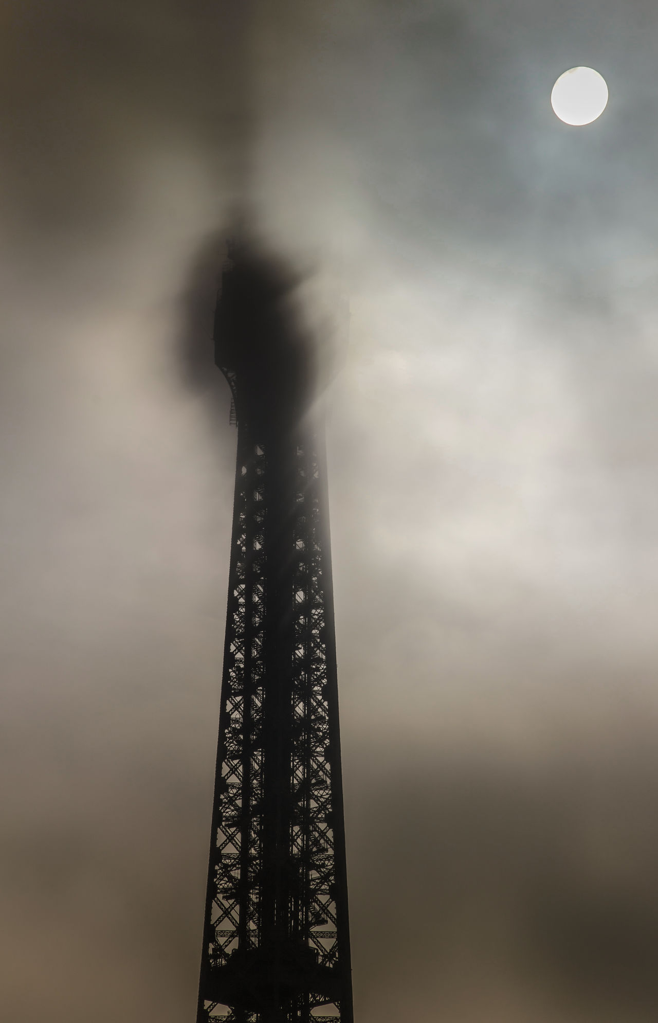 Shooting the Eiffel Tower and Trocadero on several occasions/assignments. Architecture Beautiful Light Capital Cities  Cloud - Sky Eiffel Tower Foggy Day Head Up In The Clouds International Landmark Landmark Only Partially Visible Paris Pattern Rare Weather Phenomenon Sky Steel Structure Sun Rising Against