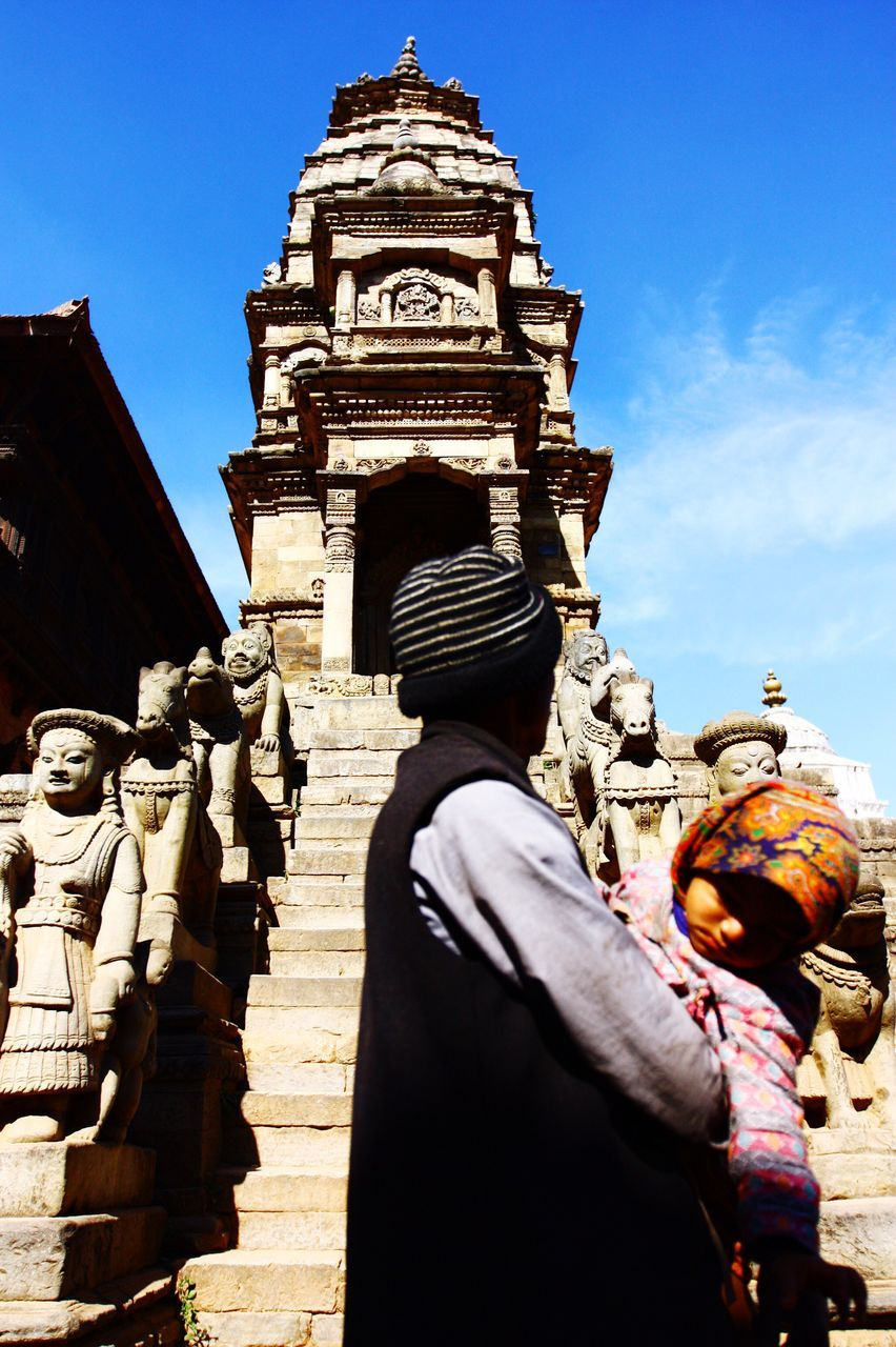 statue, human representation, male likeness, sculpture, building exterior, art and craft, architecture, low angle view, built structure, day, history, outdoors, religion, spirituality, sunlight, place of worship, sky, travel destinations, real people, ancient civilization