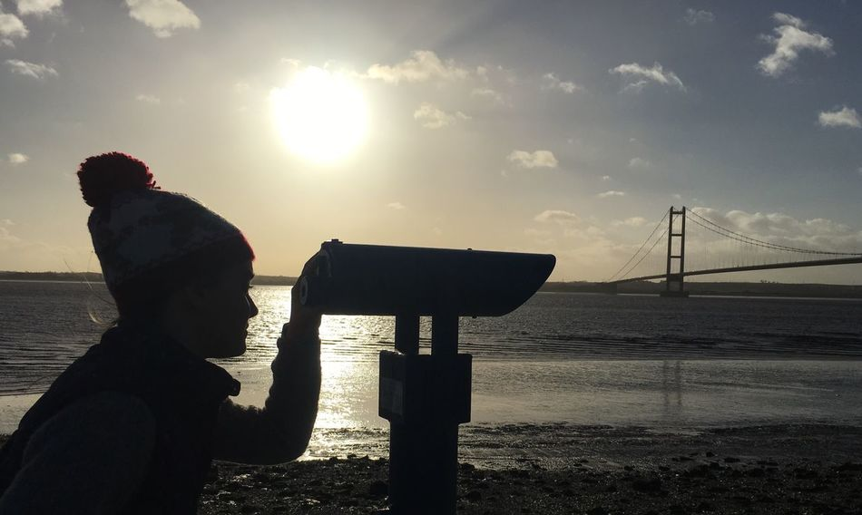 Sunlight Sky Outdoors Water Nature Tranquility Winter Blue Sky Hull 2017 River Humber Humber Bridge Beauty In Nature East Yorkshire Telescope Silhouette Girl In Bobble Hat