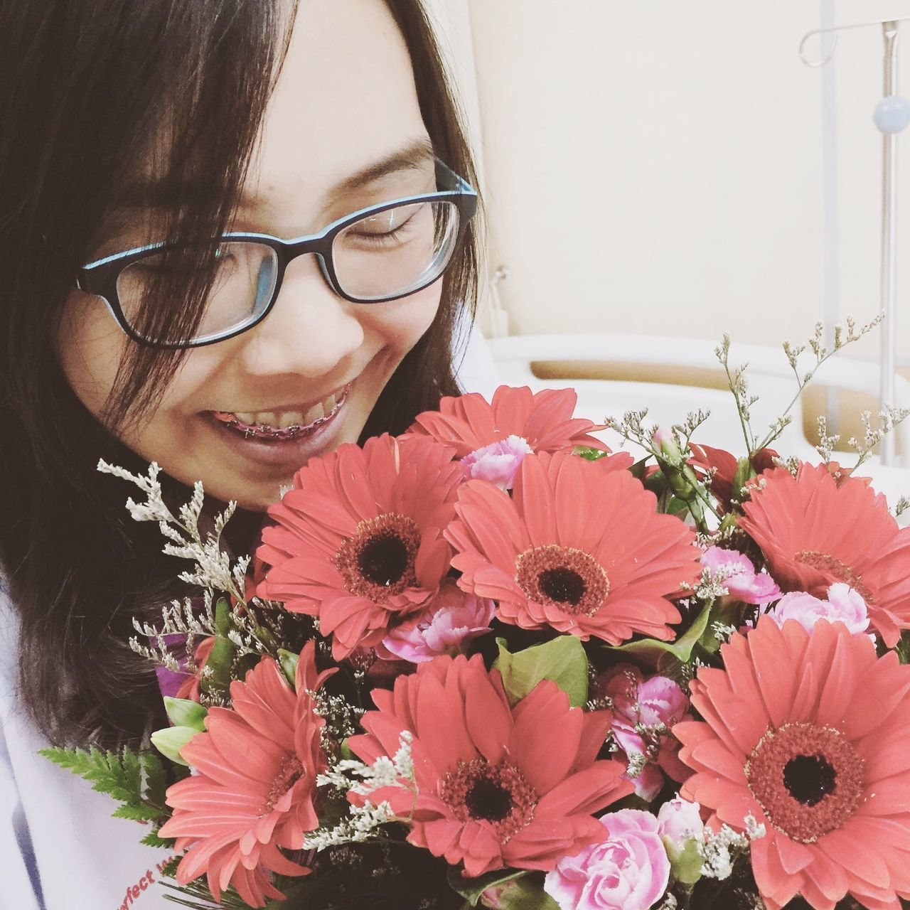 Smiling Girl With Braces On Her Teeth Holding Bouquet