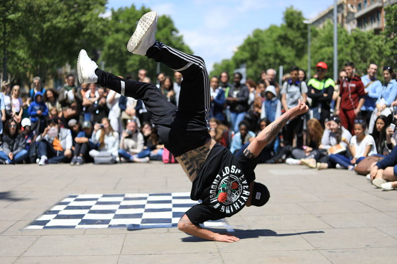 Danzer Arts Culture And Entertainment Agility Adult Motion Cool Attitude Full Length Balance Outdoors Breakdancing Individuality Only Men Lifestyles Day People Sitting Adults Only City Real People Young Adult