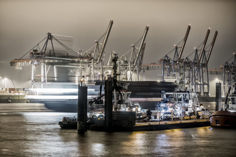 Blurred motion Blurred Motion Bugsier Business Commercial Dock Container Bridges Container Terminal Cranes Day Dock Elbe River Harbor Industry Night Working, No People Outdoors Pier Pier Reflections In The Water Sea Shipping  Sky Transportation Water