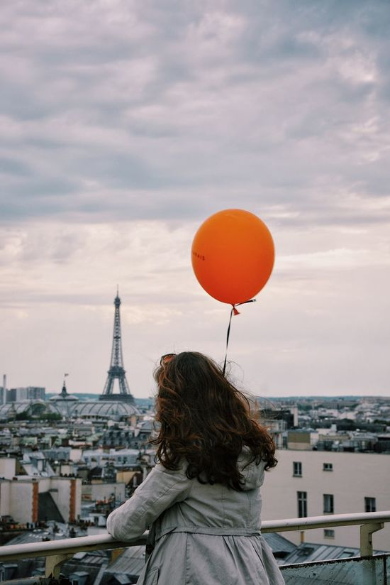 Chasing the girl with the orange balloon around Paris #3 Before moving out of Paris I wanted to portrait the city for like the 100th time. It was a really good excuse to share time with great people and went for a photo walk with friends @bnjmandre and Emily. Not having any specific purpose, while we started walking, ideas were thrown and we got to photograph the city's cliche spots, but combining them with a subject that had more impact than the iconic landmarks. This is photo #3 from this series. Paris Color Palette France Balloons City City Life Cityscapes Urban Streetphotography Travel Wanderlust Paris Skyline Urban Landscape Girl Eyeemphoto People And Places My Year My View Women Around The World The Portraitist - 2017 EyeEm Awards The Street Photographer - 2017 EyeEm Awards Your Ticket To Europe