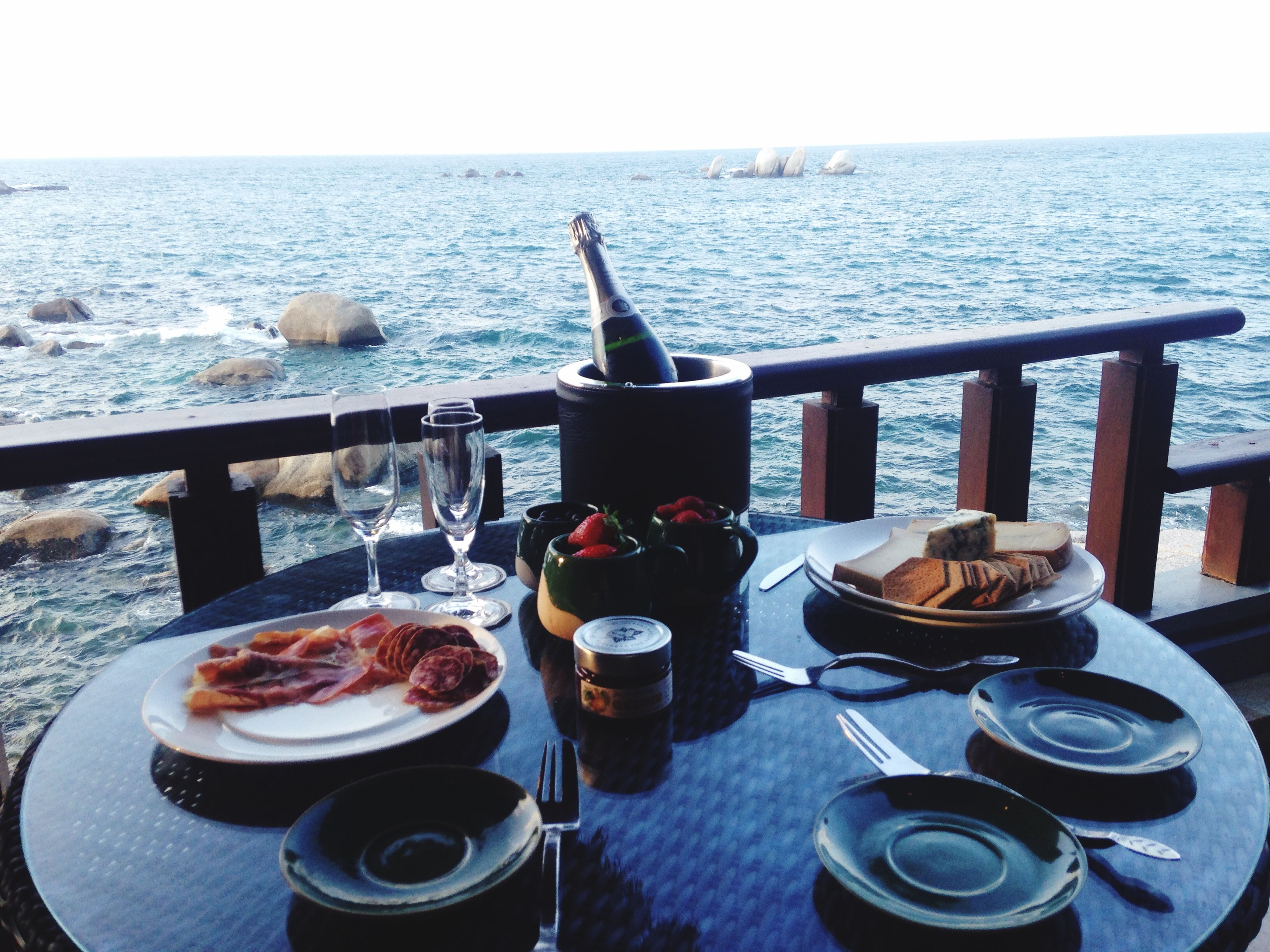 food and drink, table, sea, drink, freshness, food, water, refreshment, horizon over water, plate, coffee cup, restaurant, lifestyles, healthy eating, coffee - drink, ready-to-eat, day, breakfast, men