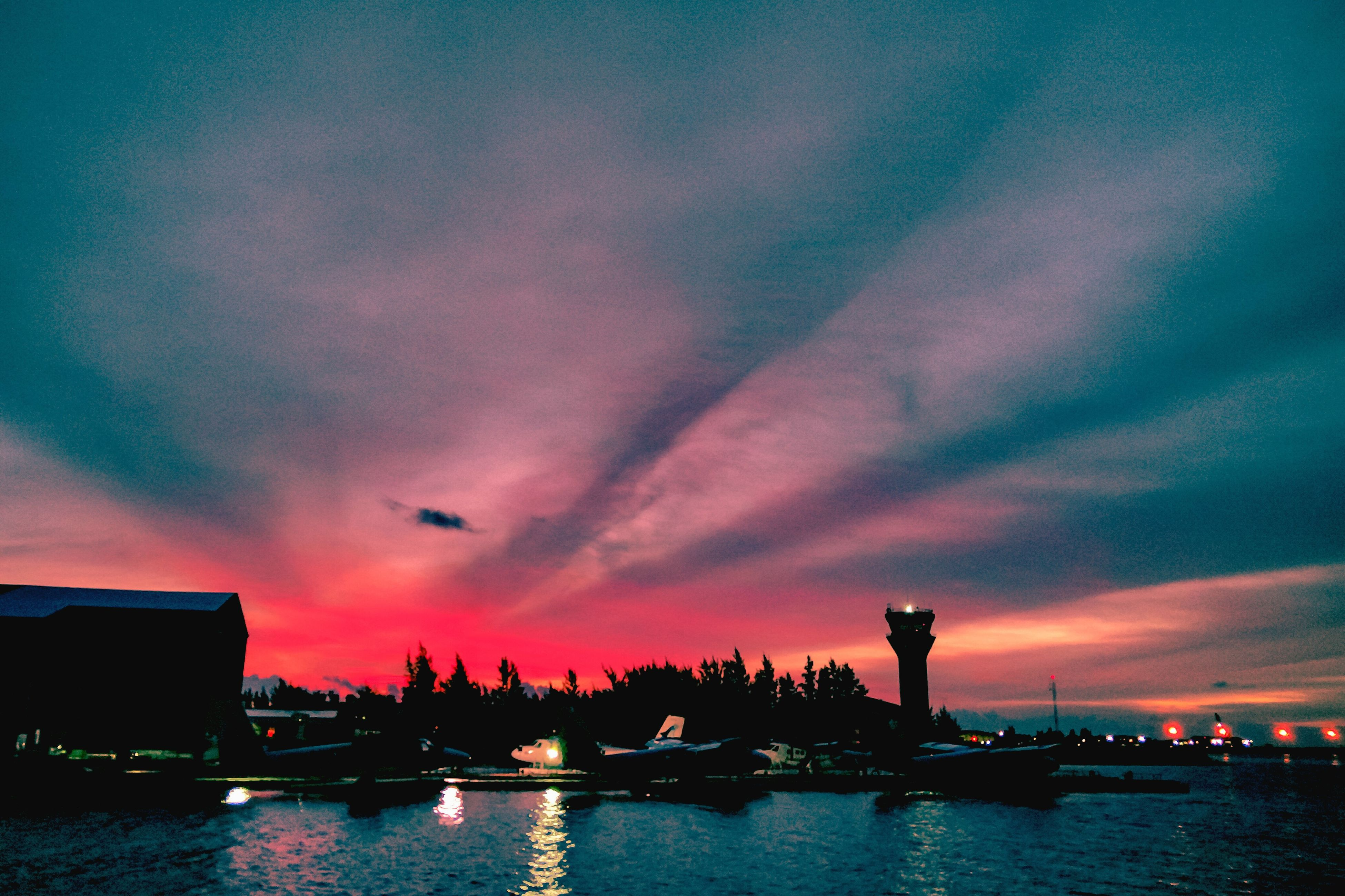 water, nautical vessel, boat, transportation, waterfront, sky, moored, river, sunset, cloud, tranquil scene, reflection, scenics, mode of transport, tranquility, illuminated, cloud - sky, dramatic sky, nature, calm, beauty in nature, outdoors, multi colored, harbor, cloudy, moody sky, outline