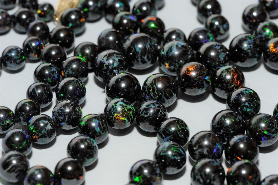 Like the Marble Universe in Men in Black Australia Backgrounds Beads Black Close-up Color Color Palette Colorful Colors Day Indoors  Large Group Of Objects Multi Colored Multicolors  Nature Nature_collection Necklace No People Opal Rare Worlds