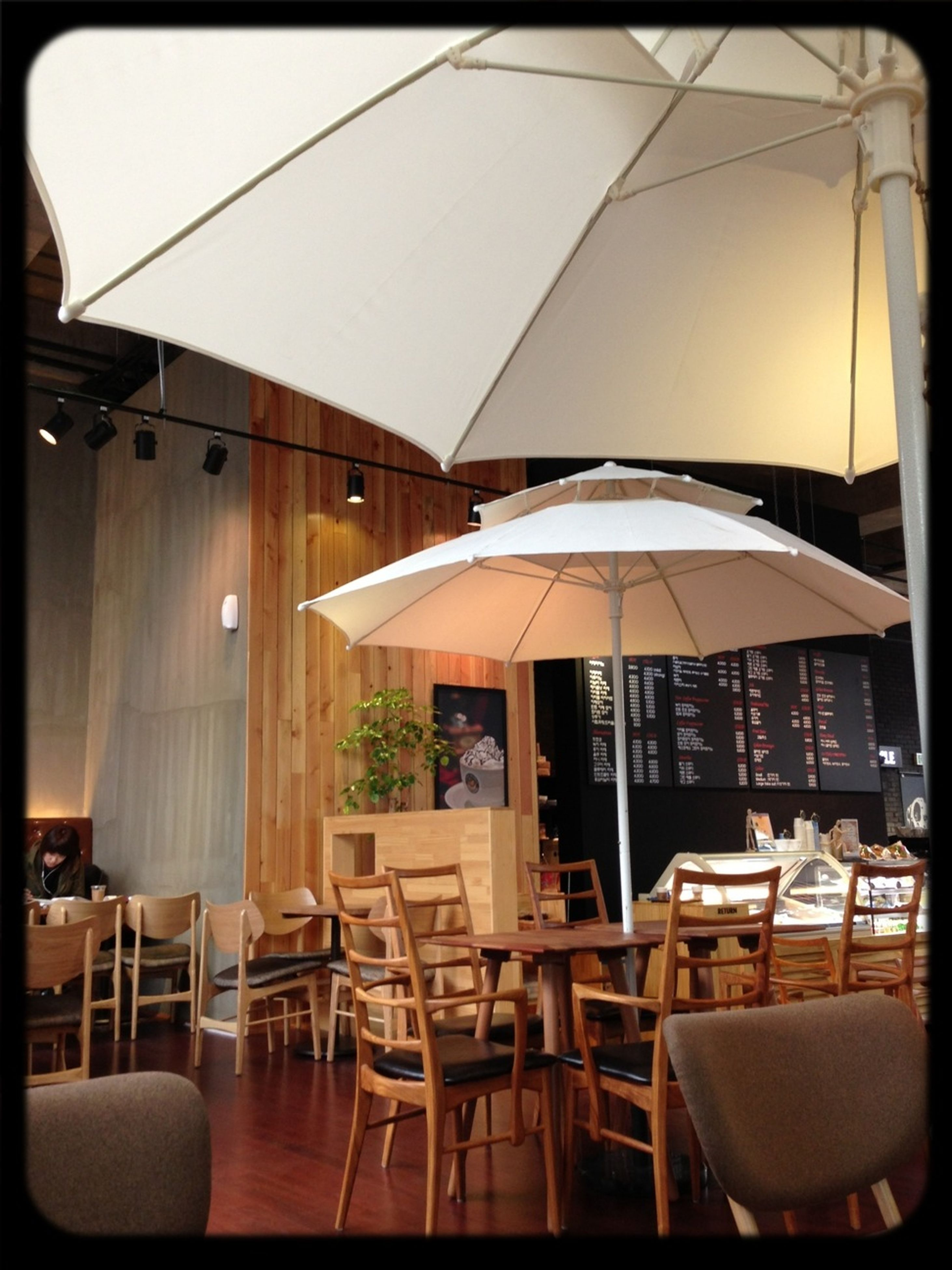 indoors, chair, table, absence, restaurant, empty, seat, window, place setting, architecture, built structure, furniture, interior, transfer print, cafe, auto post production filter, day, ceiling, sidewalk cafe, arrangement