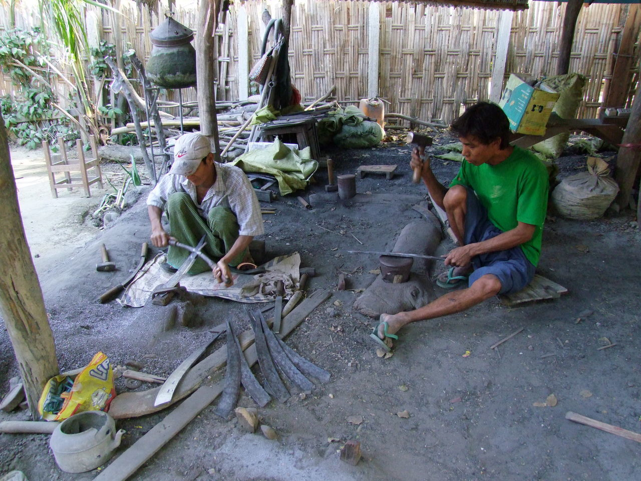 Making Knives in Tanyaung Village Composition Full Frame Full Length Hard At Work Hard Work High Angle View Making A Living Making Knives Manufacturing Men Working Men Working Hard Myanmar Outdoor Photography Real People Sitting Sunlight And Shade Tanyaung Village Traditional Clothing Two Men Two Men At Work Village Village Life Village Lifestyle Working