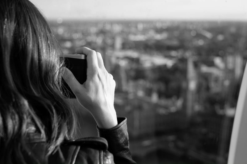 London Eye Big Ben Rear View Human Hand Photos Of Photographers Leather Jacket Blurred Background