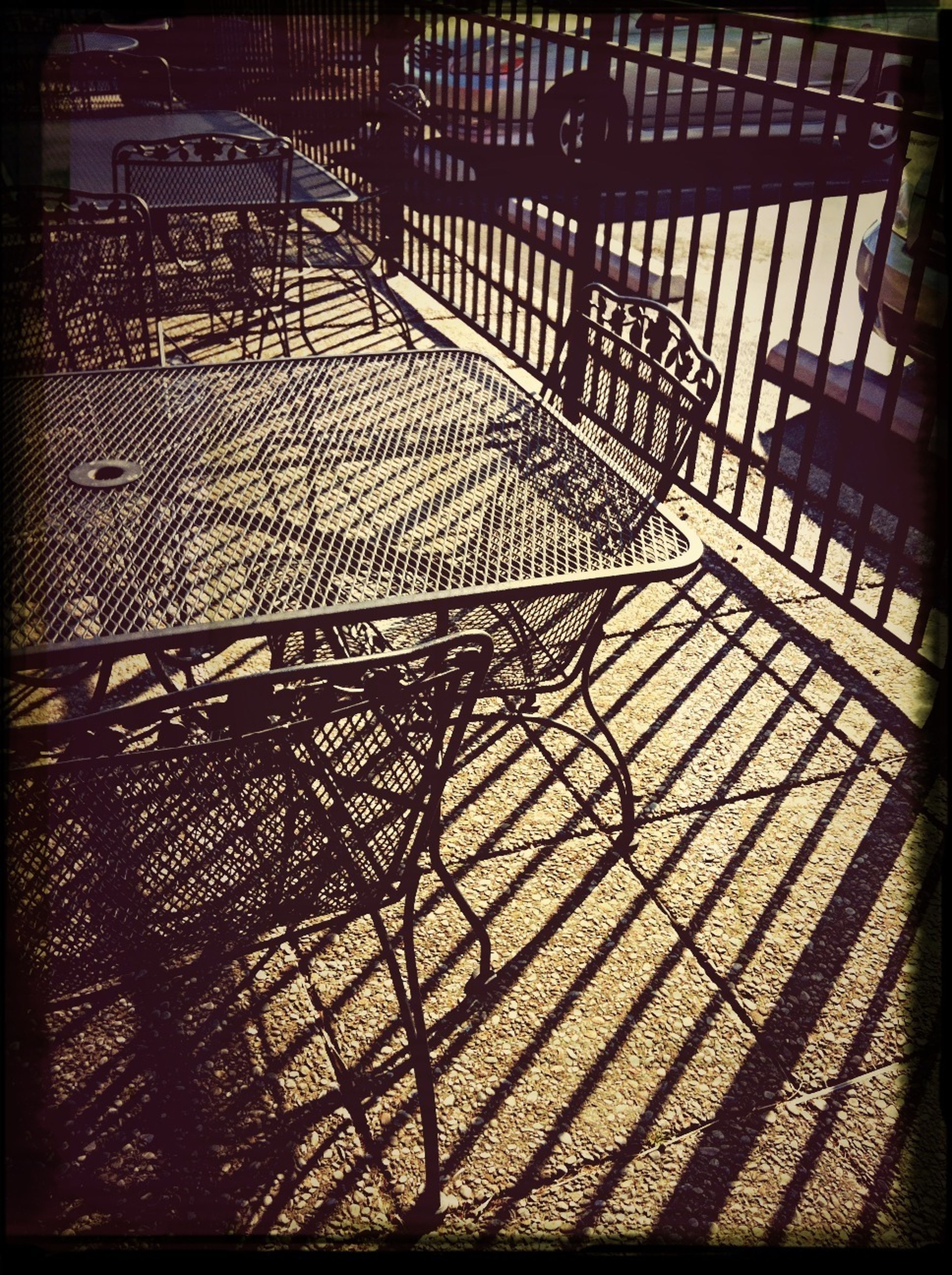 shadow, indoors, built structure, architecture, transfer print, auto post production filter, pattern, sunlight, bicycle, high angle view, design, day, metal, silhouette, wall - building feature, railing, building exterior, no people, protection