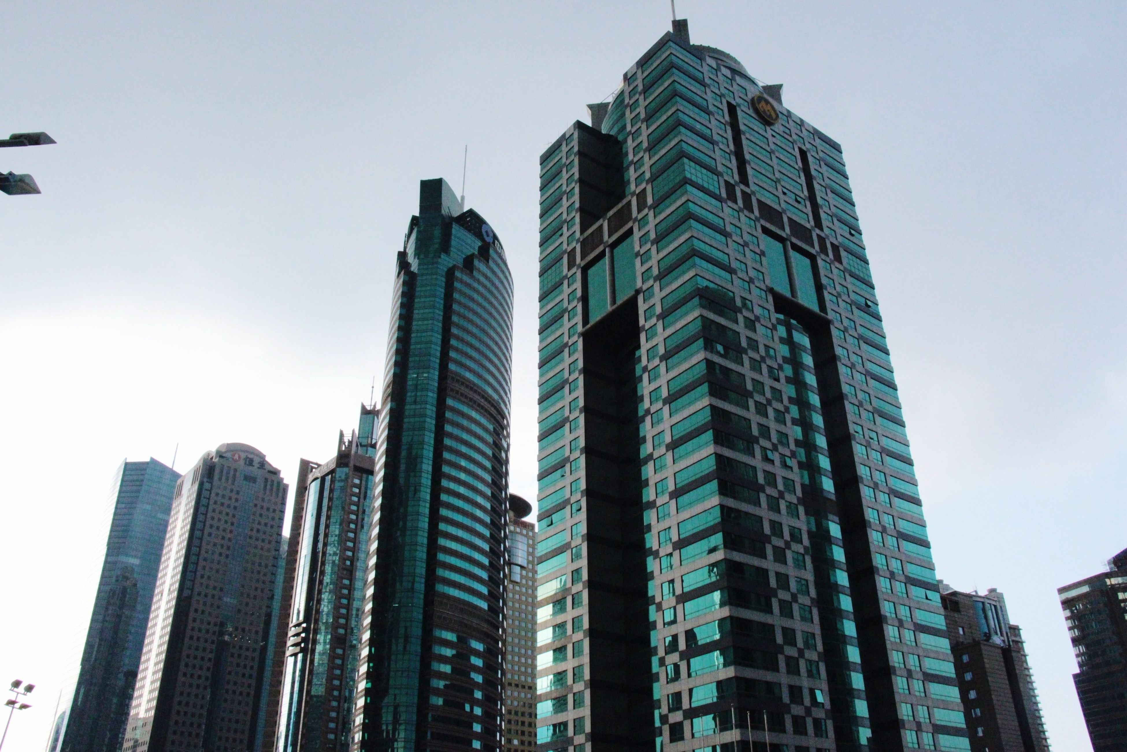 building exterior, architecture, built structure, skyscraper, city, tall - high, office building, modern, low angle view, tower, clear sky, financial district, urban skyline, building, tall, sky, city life, cityscape, capital cities, day