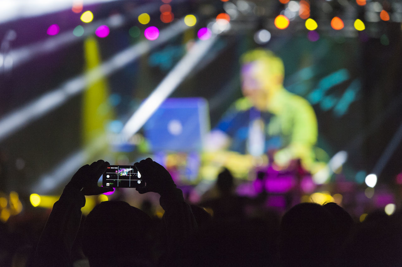 Sea dance festival. Arts Culture And Entertainment Camera City Life Con Defocused Dj Festival Festival Season Illuminated Lifestyles Lighting Lighting Equipment Live Multi Colored Music Night Nightlife Performance Shooting Smartphone Stage Taking Video Unrecognizable Person
