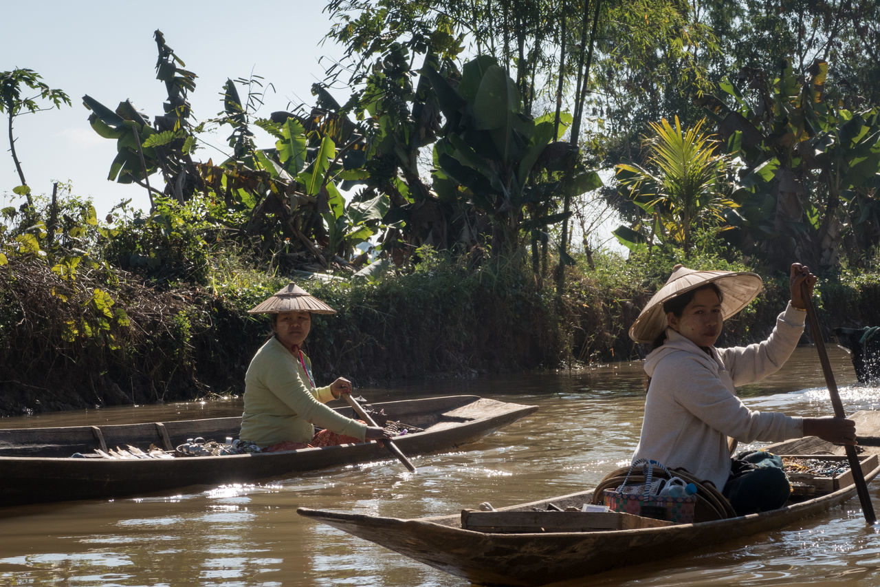 Adults Only Boat Burma Canoes Hat Inle Lake Lake Myanmar Nautical Vessel Outdoors Paddling Palm Trees Rowing Transportation Travel Destination Tree Tropical Two People Water Women