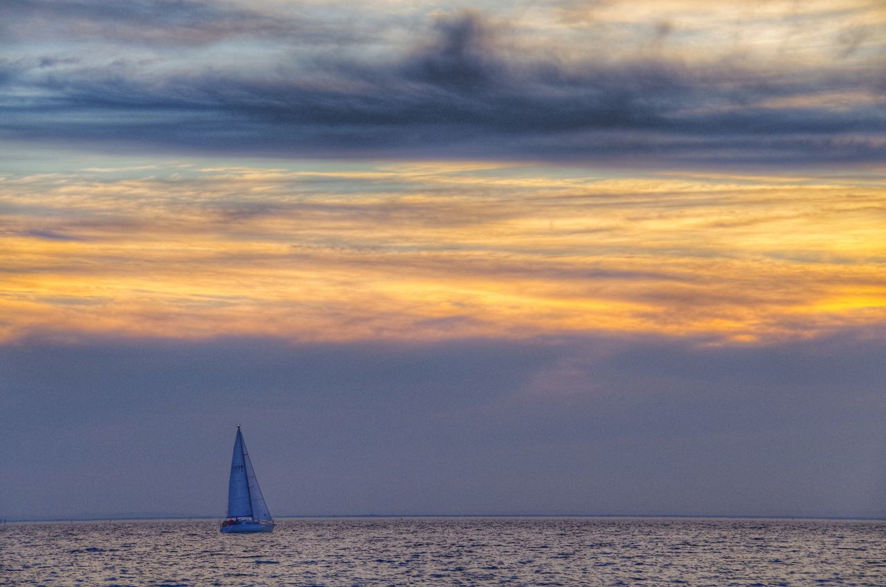 sea, cloud - sky, sky, sunset, scenics, water, beauty in nature, horizon over water, nature, tranquil scene, tranquility, transportation, nautical vessel, sailboat, outdoors, no people, sailing, vacations, day