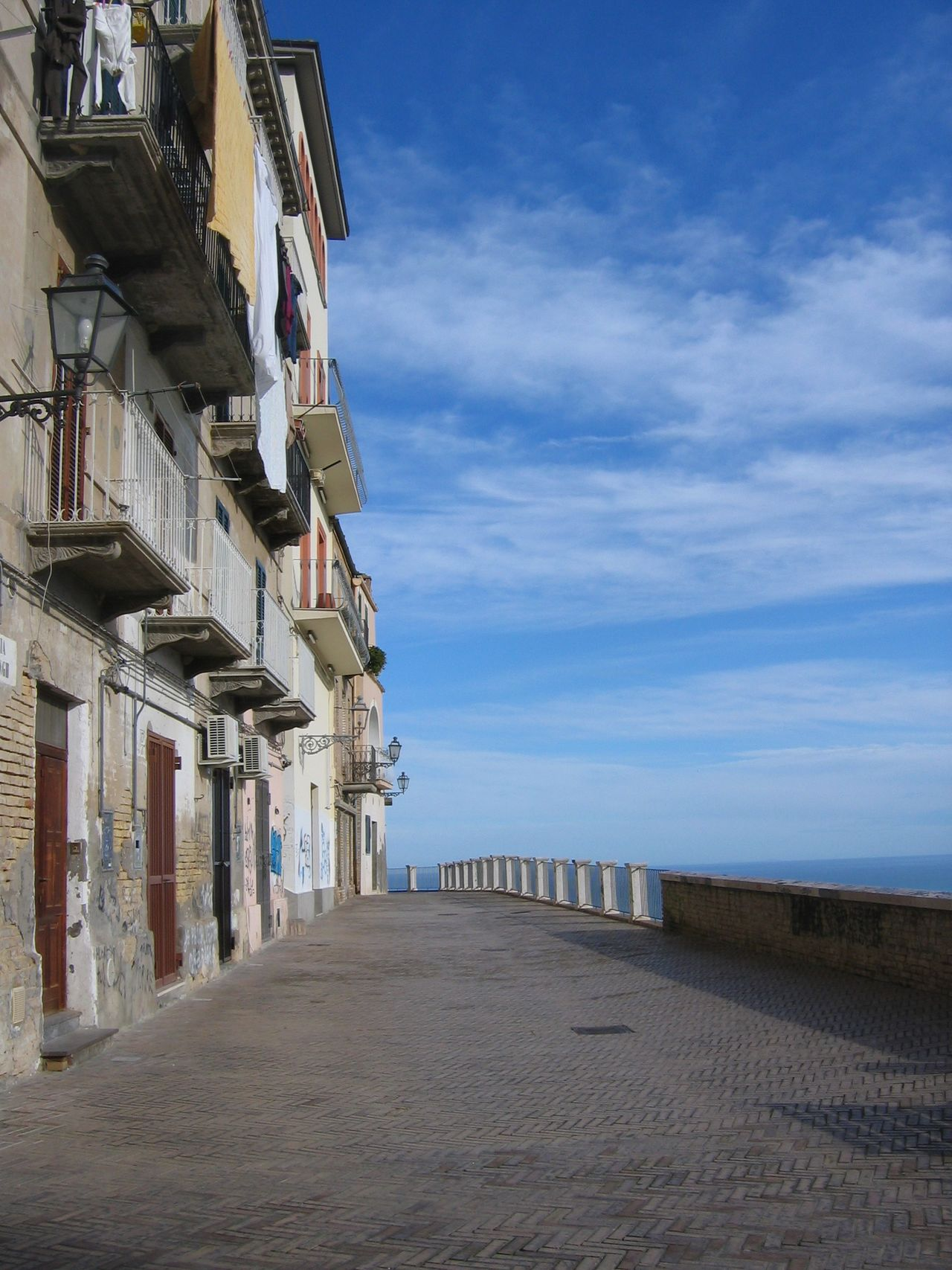 Balconys Blue Sky Building Exterior Buildings On The Left Doors Sky And Clouds Standing Linens Streetphotography Vasto Italy Sea On The Right Blu Sky