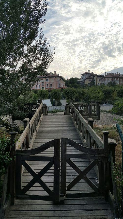 Wooden Bridge Gates Sky Clouds Riverside