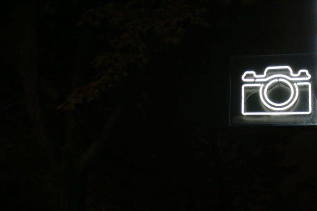 Black And White Camera Camera Sign Illuminated Neon Light Neon Sign Night Outdoors Street